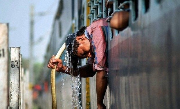 heat wave man washes head with cold water_0_0_0_0_0